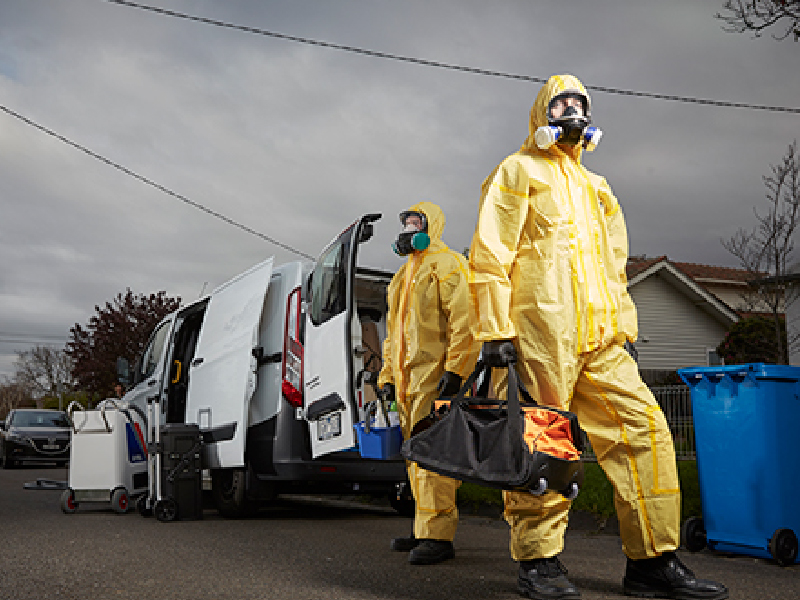 Crime Scene Cleaners in Front of Crime Scene Cleaning Company Truck